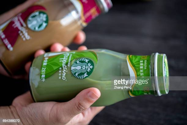 Hand holds Starbucks bottled Frappuccino arranged for photography In the first quarter of 2017 targeting to the Chinese consumers Starbucks...