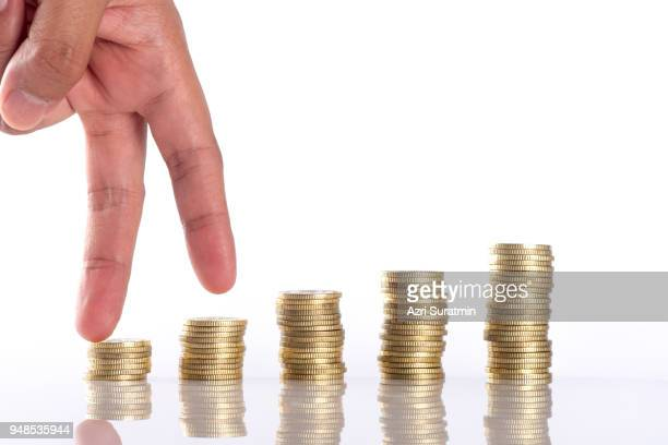 hand human hand putting coin to money, business ideas - penny for the guy stock photos and pictures