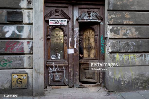 A hand in an open doorway of a property in the heart of the Jewish Kazimierz district of Krakow the location of Nazi Holocaust evacuations during WW2...