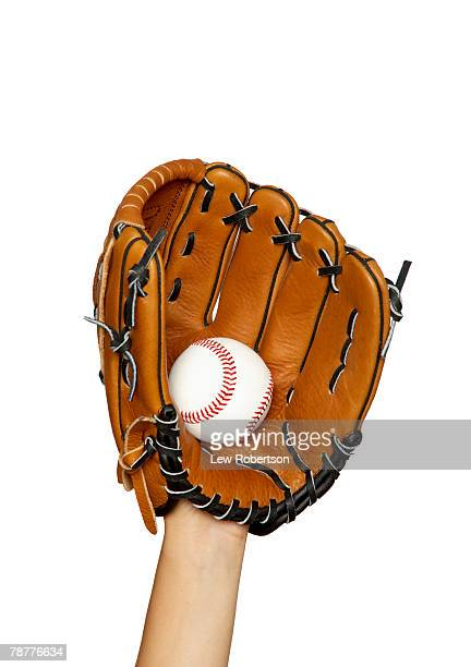 hand in baseball glove catching ball - baseball glove stock pictures, royalty-free photos & images