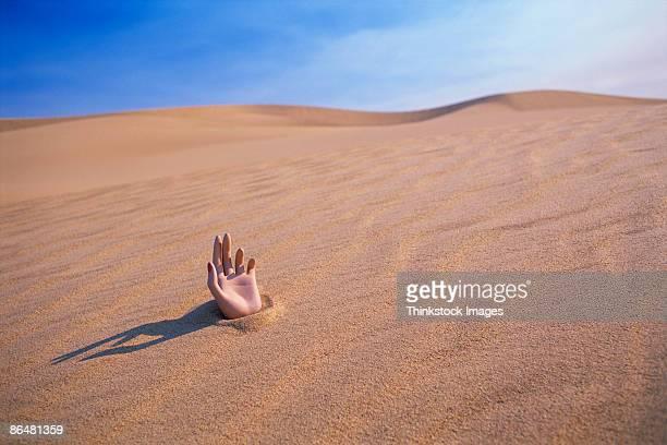 Hand in desert