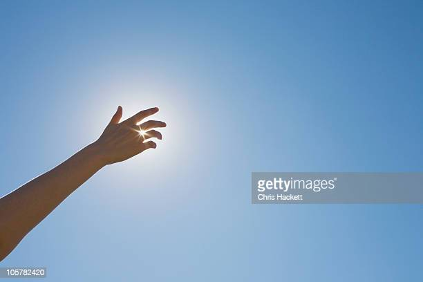 hand in front of a sun flare in the sky - gesturing stock pictures, royalty-free photos & images