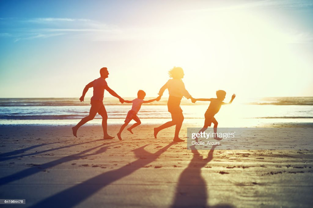 Hand in hand across the sand : Stock Photo