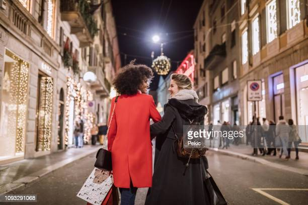 hand in hand in christmas shopping - milan stock pictures, royalty-free photos & images