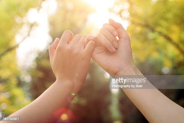 hand in hand make a promise - only girls stock pictures, royalty-free photos & images