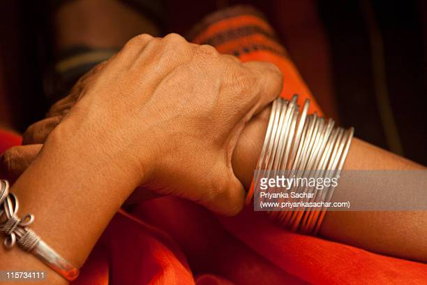 hand in hand - bangle stock pictures, royalty-free photos & images