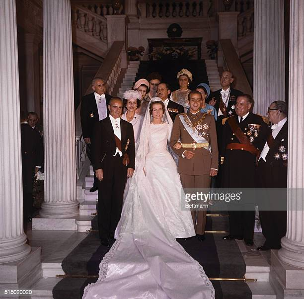 Hand in hand the Royal bridal pair pose for the press after today's wedding ceremonies. The radiant bride is Princess Sophia of Greece and her groom,...