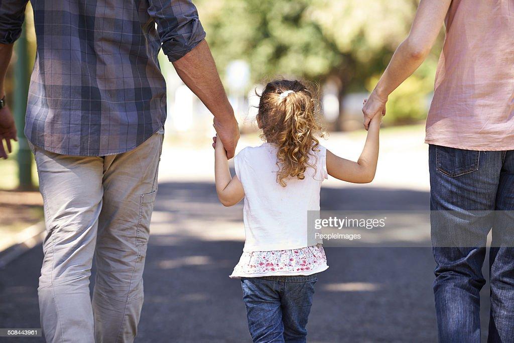 Hand in hand through childhood : Stock Photo