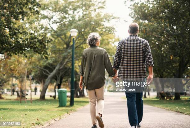 hand in hand today, tomorrow, forever - behind stock pictures, royalty-free photos & images