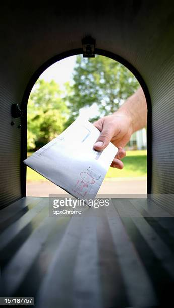 Hand in Mailbox getting Mail