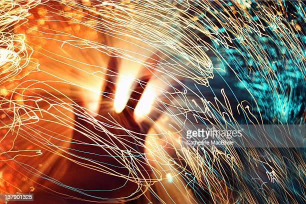 hand in streaks of light - catherine macbride imagens e fotografias de stock