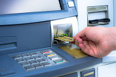 Hand inserting ATM credit card