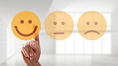 hand is selecting a happy mood smiley