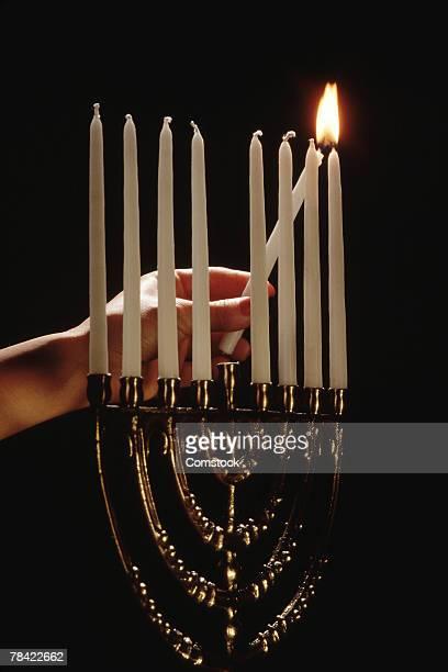 Hand lighting Menorah