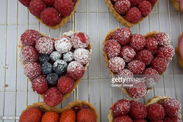 Hand made cakes are displayed on a stall in Broadway Market in east London These delicious heart shaped delicacies seem particularly romantic This...