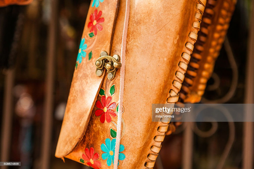 Hand made colorful leather little bags in Mexican market : Stock Photo