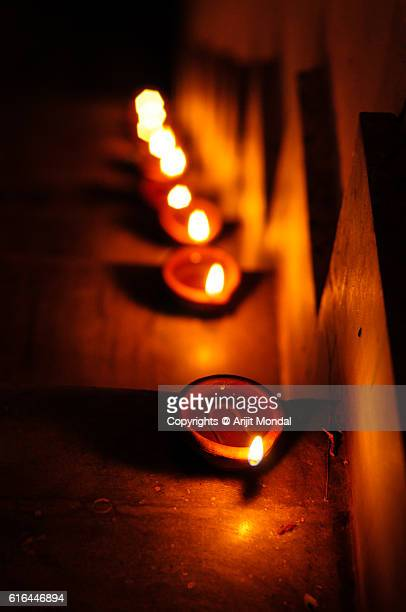 hand made oil lamps decorated in the festive night of hindu festival diwali or deepavali - diya oil lamp stock pictures, royalty-free photos & images