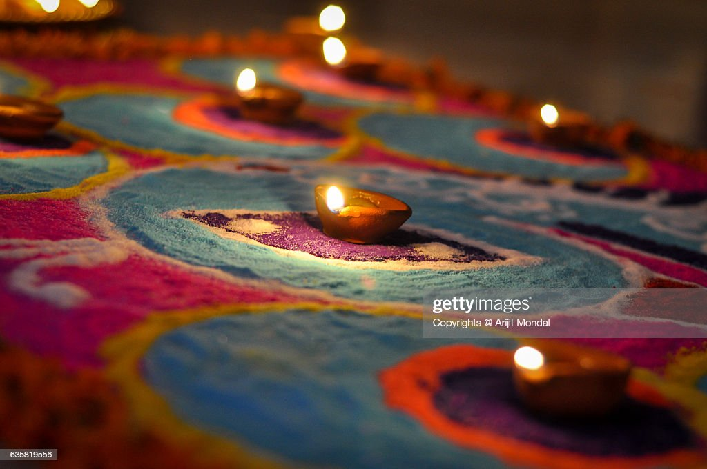 Hand made oil lamps decorated with Rangoli in the festive night of Hindu festival Diwali or Deepavali : Stock Photo