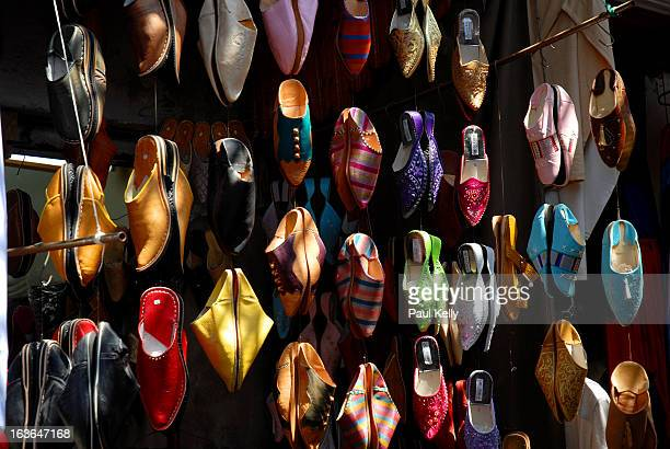 Hand made shoes hanging in a market stall in Rabat Morocco.