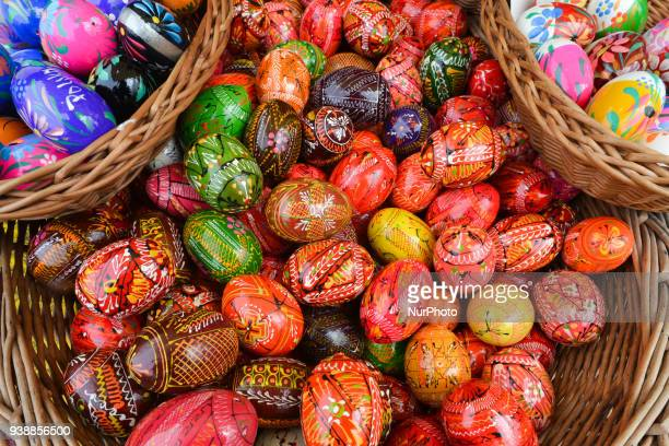 Hand made traditional hand painted Easter eggs and baskets on display for sale on Krakow's Easter market Originating as a pagan tradition pisanki...