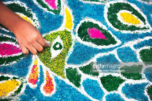 A hand making rangoli on the occasion of Diwali