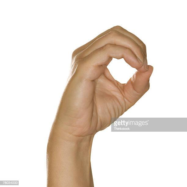 hand making zero sign - hand sign stock pictures, royalty-free photos & images