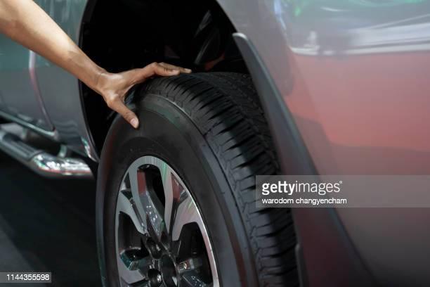 hand man checking air pressure air car tire - image - タイヤ ストックフォトと画像
