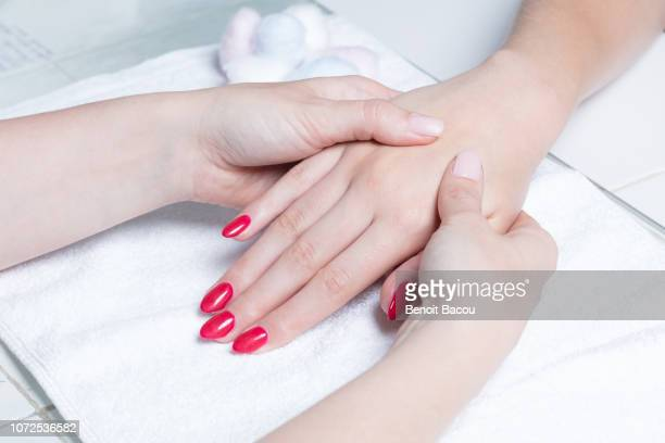 hand massage - reflexology stock pictures, royalty-free photos & images