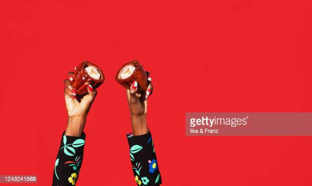 hand model holding two halves of cacao fruit - human hand stock pictures, royalty-free photos & images