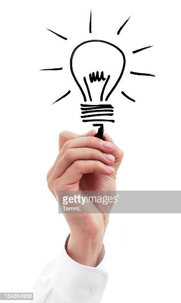 Hand of a businessman drawing Lightbulb