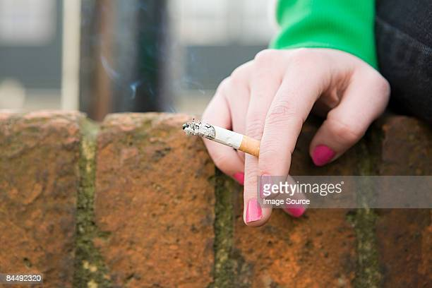Hand of a girl with cigarette