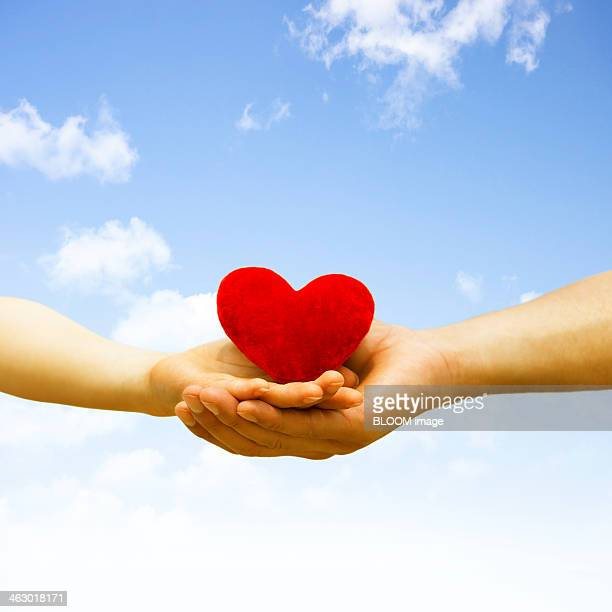Hand Of A Man And Woman Holding Heart