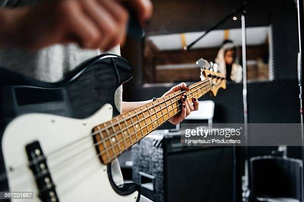 Hand of a musician on a guitar