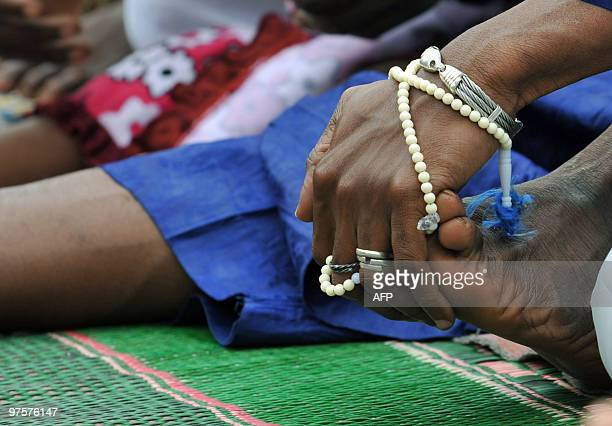 A hand of a Muslim man is pictured after a prayer on September 20 2009 in Abidjan Muslims worldwide celebrate Eid alFitr marking the end of the holy...