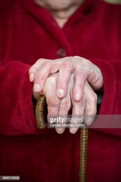 hand of a senior woman holding a cane - gerontology stock pictures, royalty-free photos & images