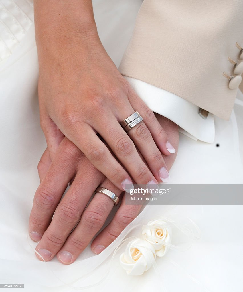 Hand Of Bride And Groom With Wedding Rings Stock Photo | Getty Images