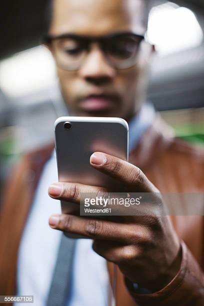 Hand of businessman holding smartphone