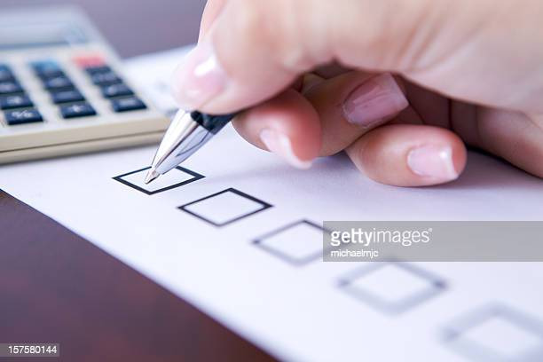 Hand of businesswoman about to start filing her to-do list
