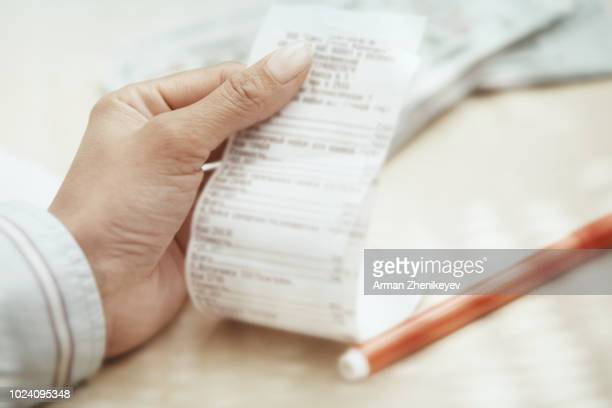 hand of businesswoman checking invoice - レシピ帳 ストックフォトと画像