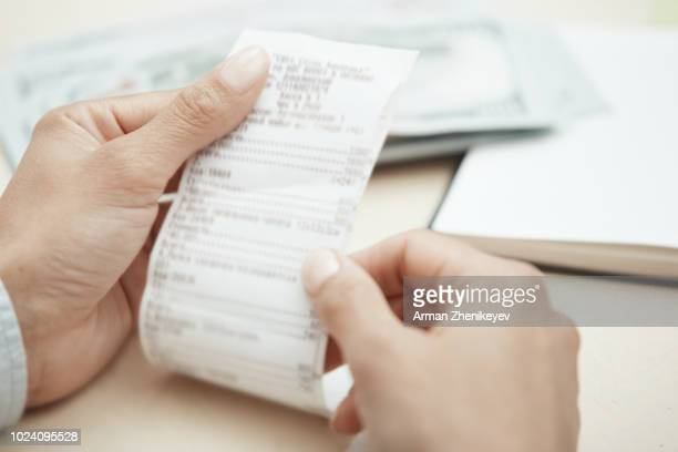hand of businesswoman checking invoice - financial bill stock pictures, royalty-free photos & images