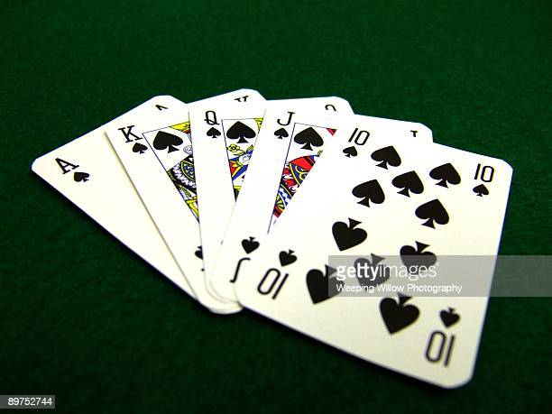 a hand of cards. - poker stock photos and pictures
