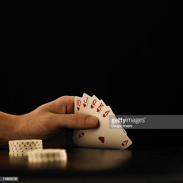 hand of cards showing a royal flush - hand of cards stock photos and pictures