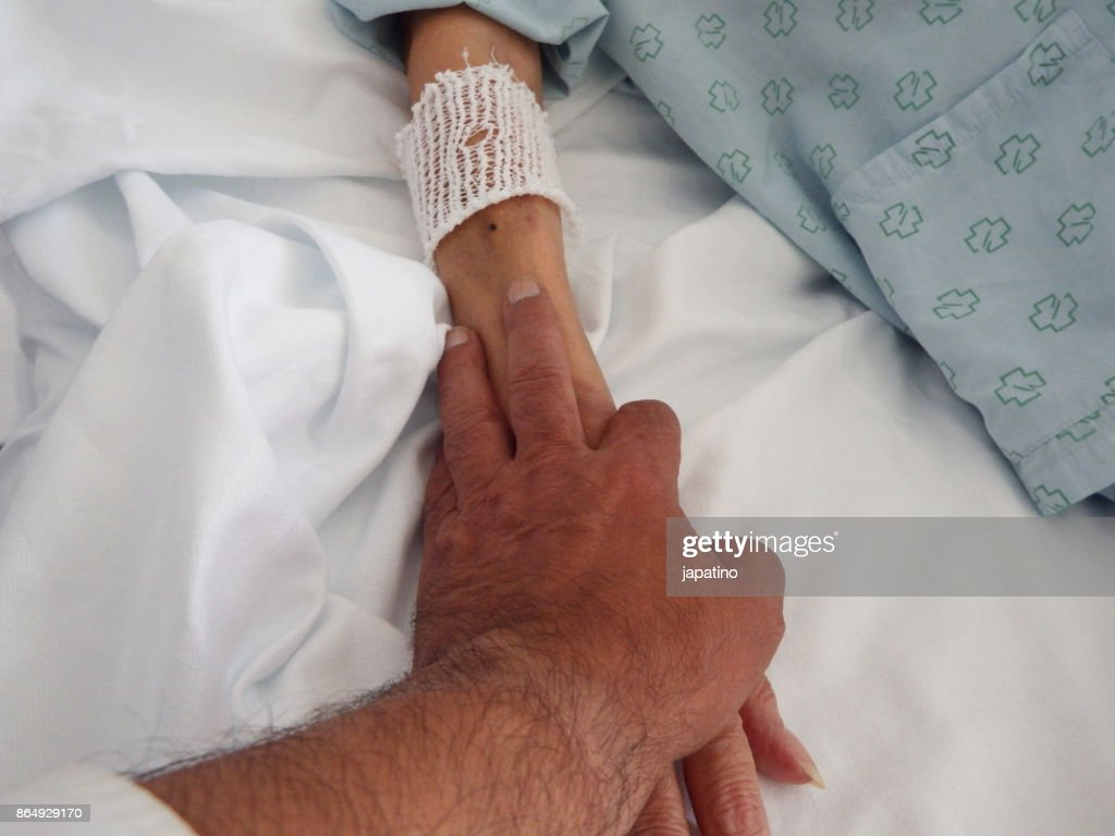 Hand of consolation and love of the sick : Stock Photo