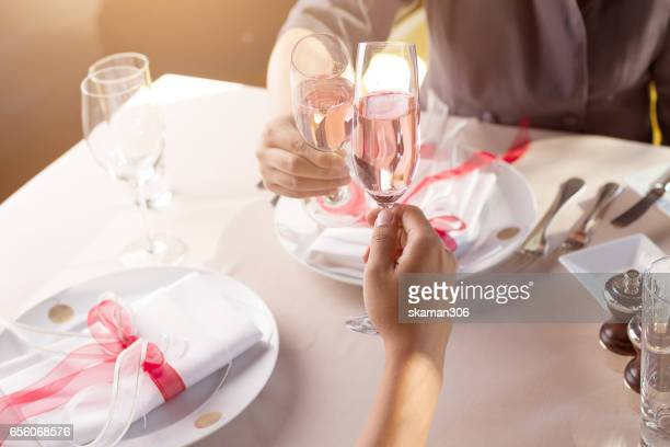 hand of couple lover holding smart-phone  and waiting for order food for valentins day