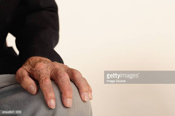 hand of elderly man - hand on knee stock pictures, royalty-free photos & images