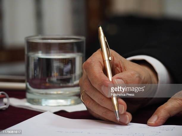 A hand of Ernesto Blume Fortini president of the Constitutional Tribunal of Peru when giving a press conference to foreign correspondents accredited...