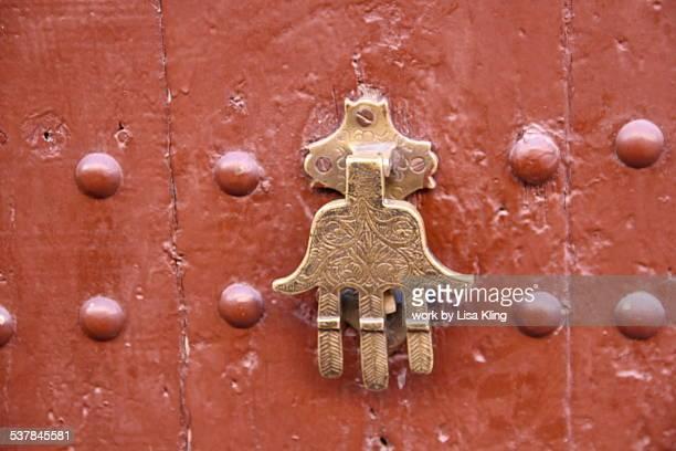 hand of fatima, door knocker - hand of fatima stock photos and pictures