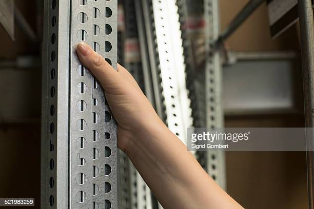 hand of female customer selecting metal bars in hardware store - sigrid gombert stock pictures, royalty-free photos & images