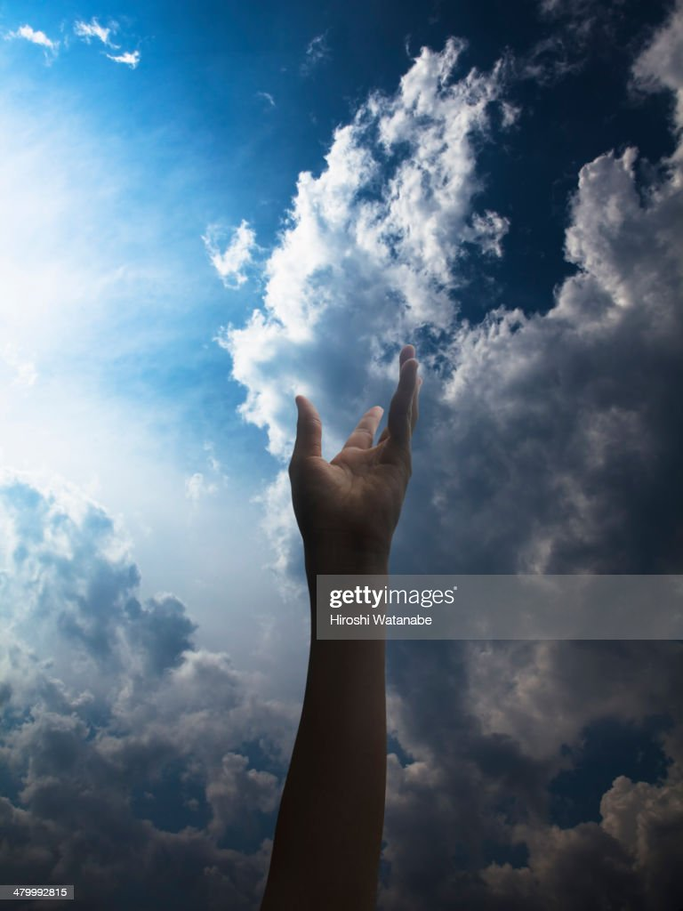 Hand of girl in the sky : Stock Photo