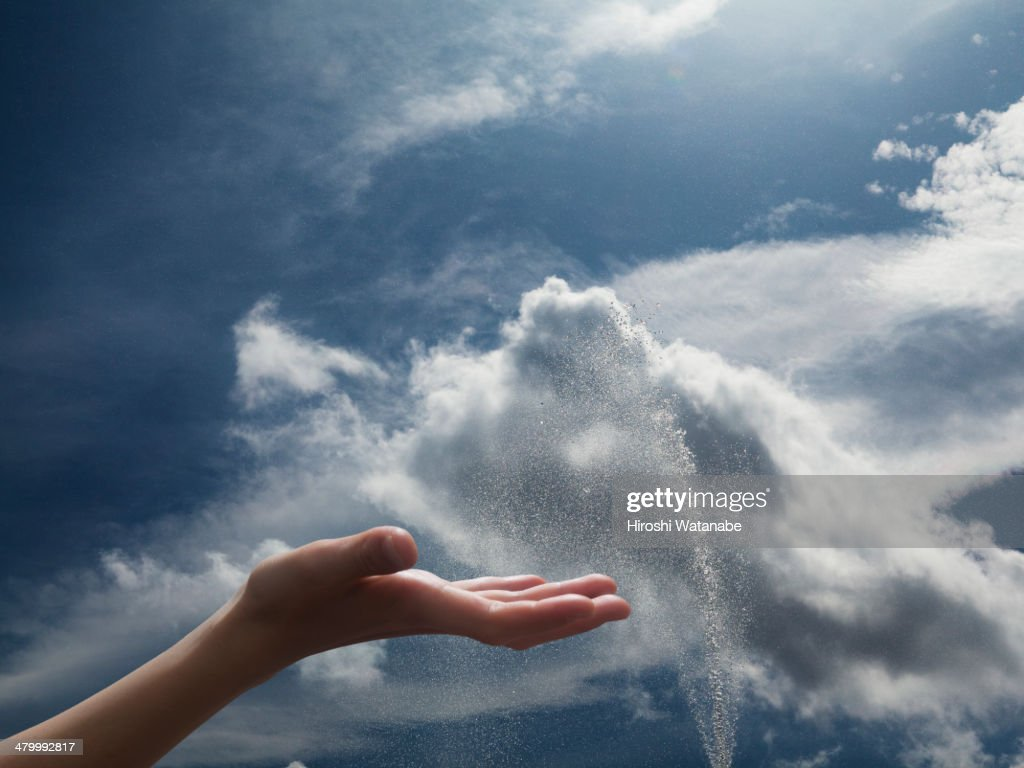 Hand of girl in the sky with fountain : Stock Photo
